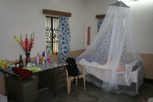 My bedroom , mosquito net and all.