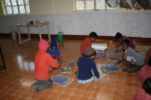 Class 3 boys busy painting